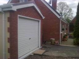 Brick Front Modular Integrated Garage