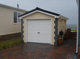 Roughcast Stipple Modular Garage with Quoin Stones